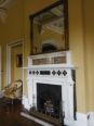 Ballroom fireplace with the original glass panel inserted along the top