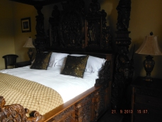 One of the bedrooms with 4 poster bed