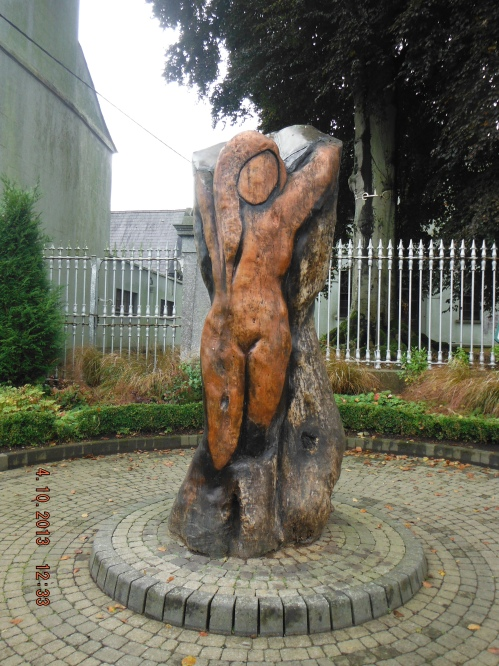 "The sculpture ""Angel of the Past"" is by a local artist, Patrick Morris, carved from a sycamore tree which stood here when Charles Stewart Parnell addressed the people of Kells about land rights for Irish tenants and Home Rule."
