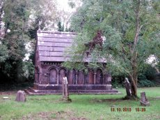 The Mausoleum is to one side of this small churchyard