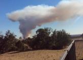 Smoke billows into the air