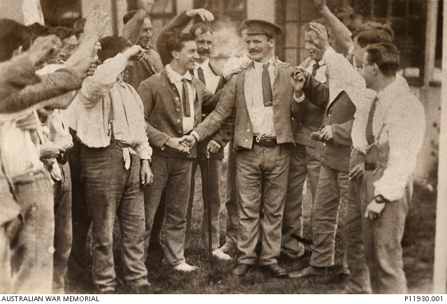 September 1916. 3970 Private (Pte) Martin O'Meara being congratulated by fellow hospital patients, at Wandsworth, all wearing 'hospital blues', following the announcement of his Victoria Cross award. (Image Australian War Memorial, Public Domain)