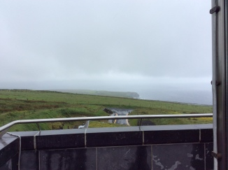 The cliffs to the west of the site, shrouded in mist