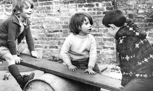 children playing seesaw