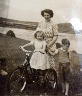 Di, her son Gerry and me on my red trike at the point of Figart c.1953 (thesilvervoice)