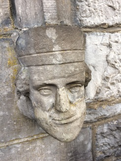 One of two carved faces at main entrance