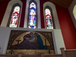 Lovely stained glass windows with mosaic memorial.