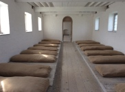 A dormitory, with straw beds. they may have had a blanket or rag to keep warm as they slept